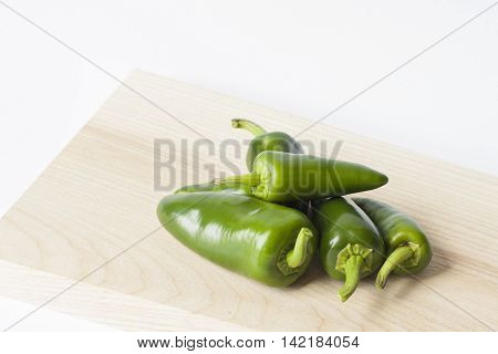 set of green jalapeno peppers close up