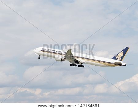 The Moscow region - 31 July 2016: Beautiful passenger plane Boeing 777-312ER Singapore Airlines taking off at the airport Domodedovo 31 July 2016 Moscow region Russia