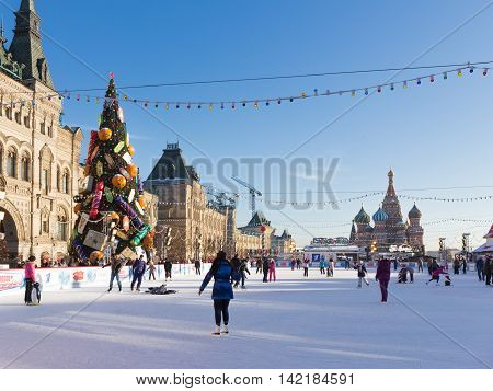Moscow - November 29 2015: Beautiful Christmas ice rink on Red Square and a lot of people are skating during the Christmas holidays and St. Basil's Cathedral November 29 2016 Moscow Russia