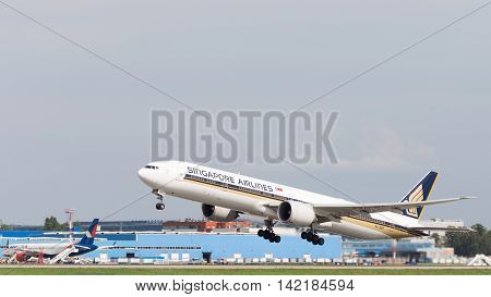 The Moscow region - 31 July 2016: Large passenger plane Boeing 777-312ER Singapore Airlines taking off at the airport in Moscow's Domodedovo 31 July 2016 Moscow region Russia