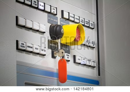 Group of selective put button and emergency switch of Auto-Manual on electrical control panel with name tag. Selective