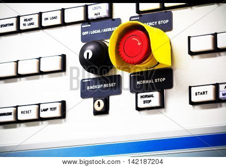 Group of selective put button and emergency switch of Auto-Manual on electrical control panel with name tag.Selective
