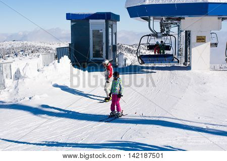 Kopaonik, Serbia - January 22, 2016: Ski resort Kopaonik, Serbia, ski lift, ski slope, people skiing down from the lift and skiing