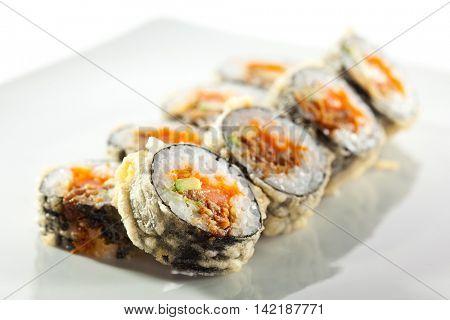 Tempura Maki Sushi - Deep Fried Roll made of Fresh Salmon, Avocado Smoked Eel and Tobiko Caviar inside