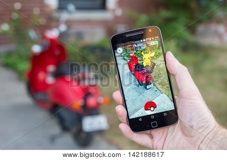 Montreal, Ca - August 10, 2016: Closeup Of A Man Playing Pokemon Go On A Smart Phone. Pokemon Go Is