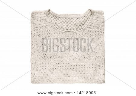 Folded beige lacy pullover isolated over white