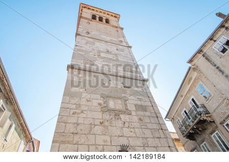 Tower bell of St Mary's church in old town Cres, Croatia