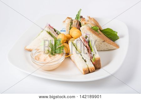 Sandwiches with cheese balls served on a white plate
