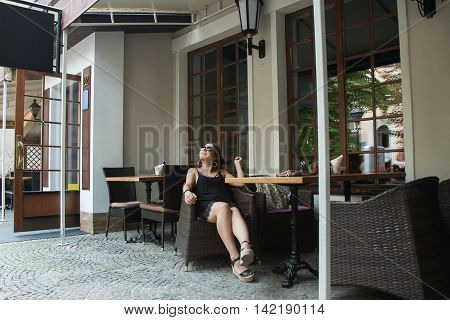Hipster Woman Sitting At Cafe