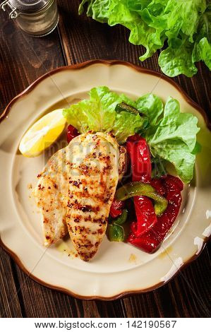 Grilled Chicken Breasts Served With Grilled Paprika