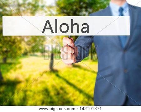 Aloha - Businessman Hand Holding Sign