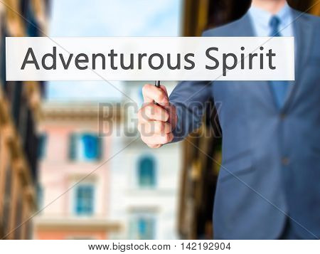 Adventurous Spirit - Businessman Hand Holding Sign