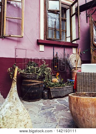 Rustic front porch with barrels and violet walls