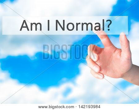 Am I Normal ? - Hand Pressing A Button On Blurred Background Concept On Visual Screen.