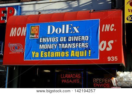 New York City - November 25 2006: Biliingual signs in Spanish and English on an Amsterdam Avenue money exchange shop in upper Manhattan
