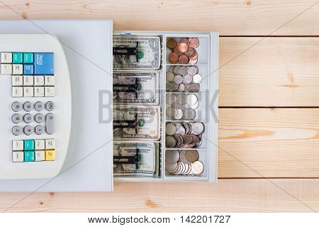 Cash Register Full Of Coins And Paper Money