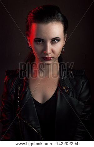 girl in a black leather jacket, the image of a vampire on Halloween, rock star posing with aggressive appearance