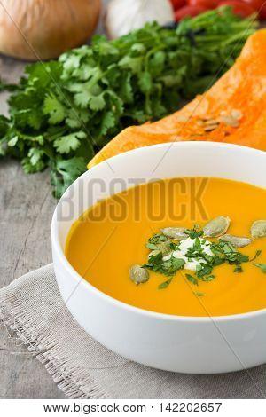 Pumpkin soup in bowl and pumpkin seeds