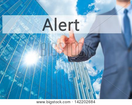 Alert -  Businessman Press On Digital Screen.
