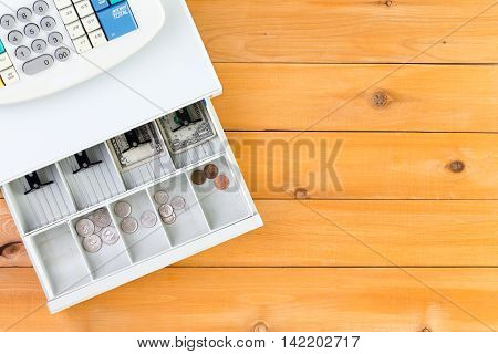 Nearly Empty Cash Register Drawer On Table