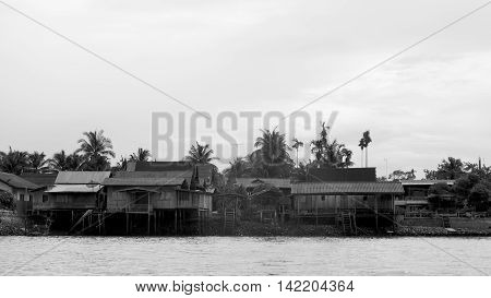 Thailand wood homes antique and very old is near riverside travel tour in Asia
