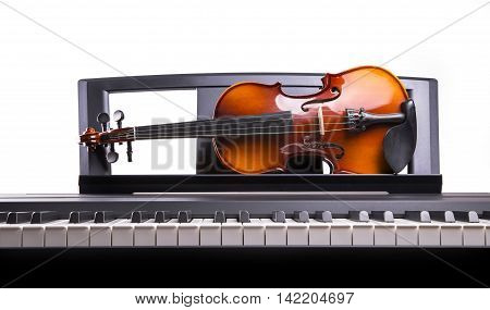 Violin lying on the desk electronic piano