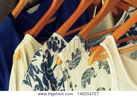 collection of women's clothes hanging on hangers