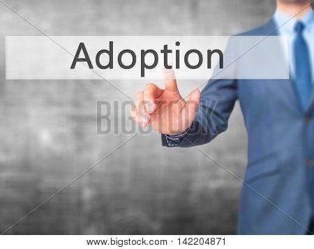 Adoption -  Businessman Press On Digital Screen.