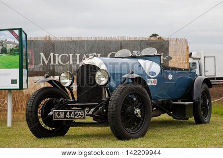WEEDON, UK - AUGUST 27: A vintage blue Bentley sports car is put on public display as part of one of the numerous commercial stands at the Bucks County show on August 27, 2015 in Weedon