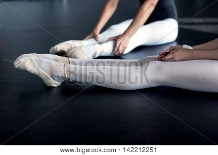 Young female dancers and their beautiful legs in the ballet shoes