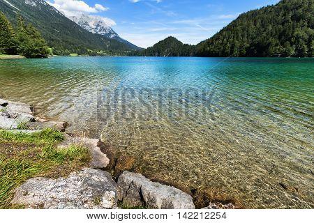 Clear water in a mountain lake. Hintersteiner Lake Tyrol Austria.