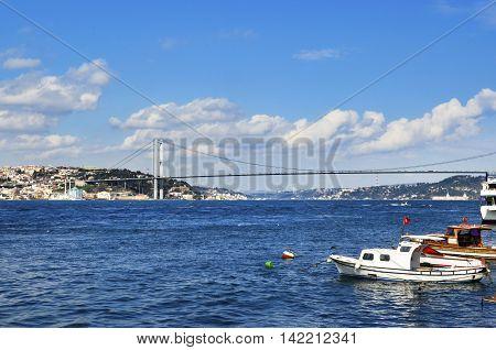 Istanbul Turkey - March 10 2013: View of the European side of Istanbul from the Bosphorus. The Bosphorus Bridge (Turkish: Bogazici Koprusu) also called the First Bosphorus Bridge is one of two suspension bridges spanning the Bosphorus strait