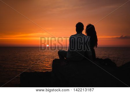 Young Couple In Love Against Sunset At Sea