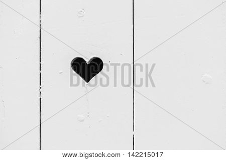 Heart Shaped Hole In White Wooden Wall