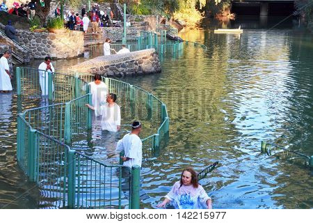 YARDENIT, ISRAEL-JANUAR 21: Christian pilgrims ritual baptism in the waters of the Jordan River in the days of the Feast of Holy Baptism 21 January 2012 at Pilgrim baptismal site Yardenit,