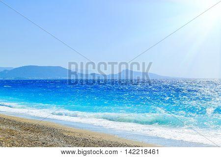 beach pebble beach summer sun wave Rhodes Greece