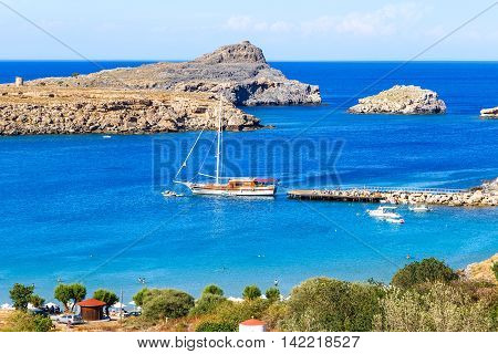 Greece. Rhodes Island. The town of Lindos and sea bay at sunset