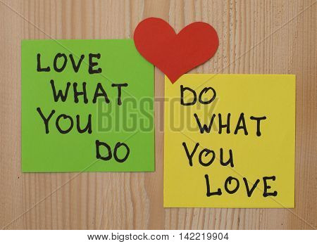 Yellow and green note paper with red heart on rustic wooden background. 'Love What You Do and Do What You Love' notes. I love my job concept