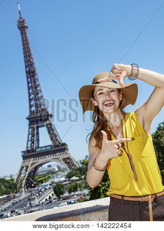 Smiling Woman Framing With Hands In Front Of Eiffel Tower, Paris