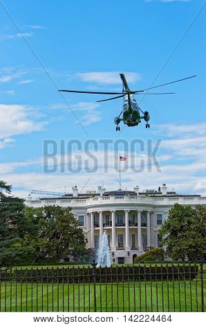 Helicopter flying towards the White House in Washington D.C. USA. It is one of the main symbols of the US government. It is the workplace and residence of the current President of the United States.