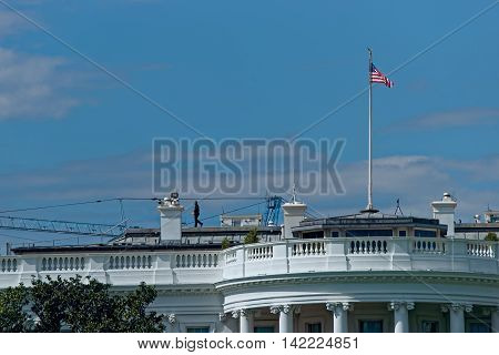 Man On The Roof Of White House