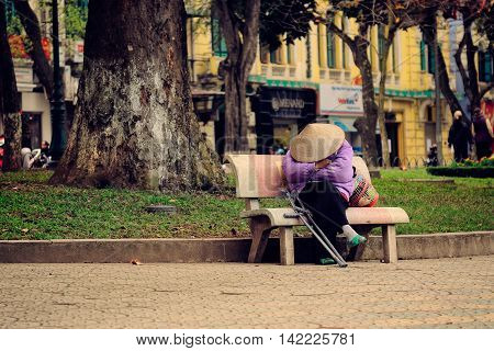 Hanoi, Vietnam - 10 March,2012: The woman sleep on the bench at Hoan Kiem lake