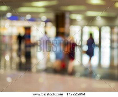 Bright blur of people in shopping center.