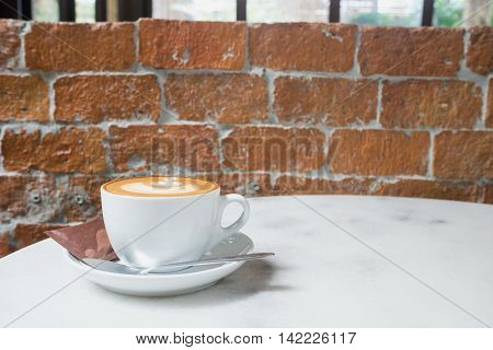 hot fresh coffee in white cup on marble table brick wall and white saucer sugar and cream cappuccino coffee mocha coffee espresso coffee latte coffee