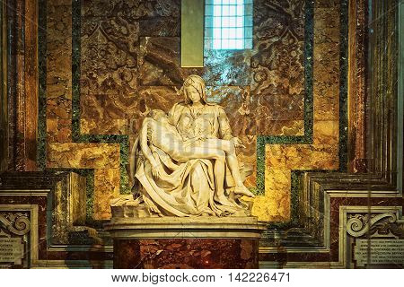 Rome Italy - August 28 2012: Pieta sculpture by Michelangelo in Saint Peter Basilica in Vatican in Rome in Italy