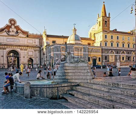 Tourists At Fountain In Piazza Del Popolo In Rome Italy