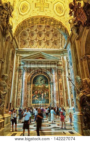 Tourists In Saint Peter Basilica Building In Vatican In Italy