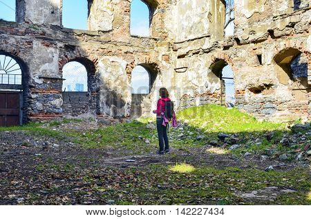 Istanbul Turkey - March 10 2013: Old brick and stone walls the ruins of buildings. A female tourist environmental analyzes shown in the photograph. The ruins of buildings built between 1798-1802 as a granary history in Istanbul.