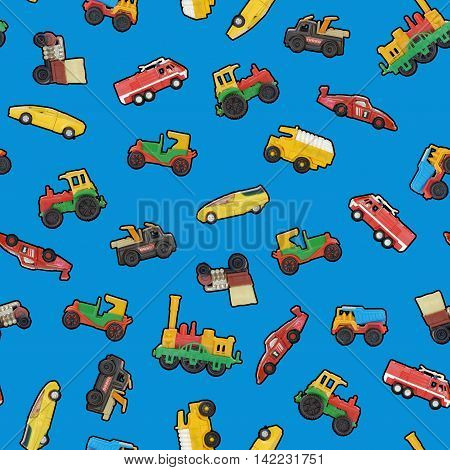 Toy cars seamless wallpaper or blue background