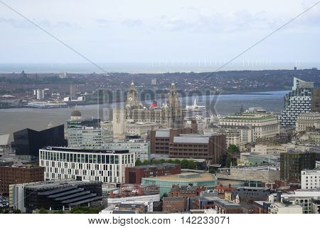 LIVERPOOL ,ENGLAND, JULY 2. Pier Head and the Mersey River on July 2, 2016, in Liverpool, England. Liverpool landmarks include The Royal Liver Building Merseyside Cunard Building Port of Liverpool Building and Princes Dock.